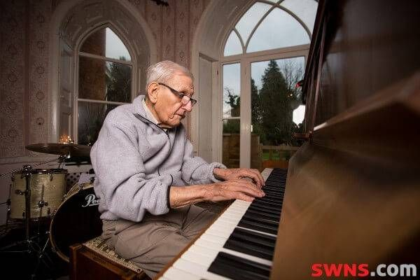 Edward Hardy plays piano in his retirement home.