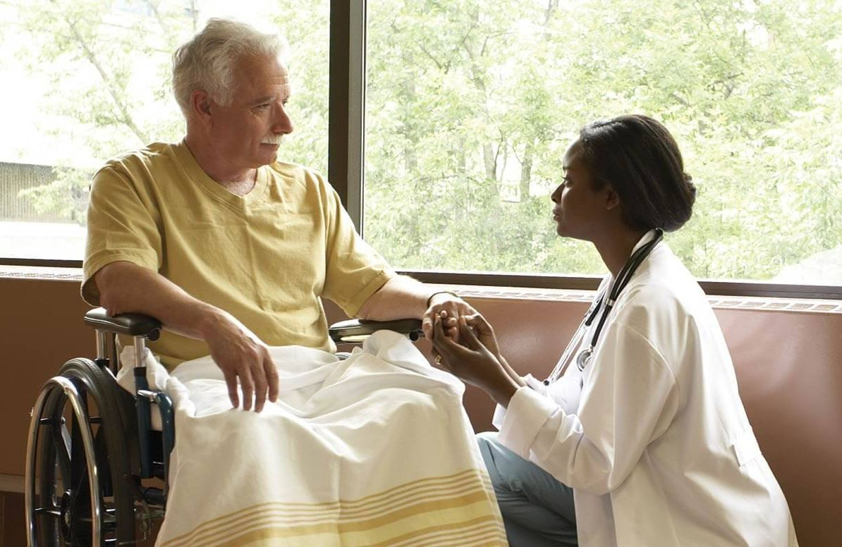 Woman caring for patient