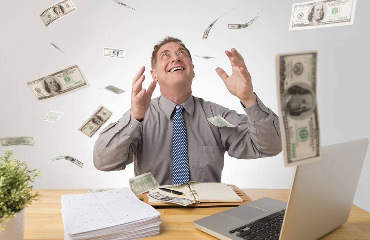 Man celebrating financial freedom