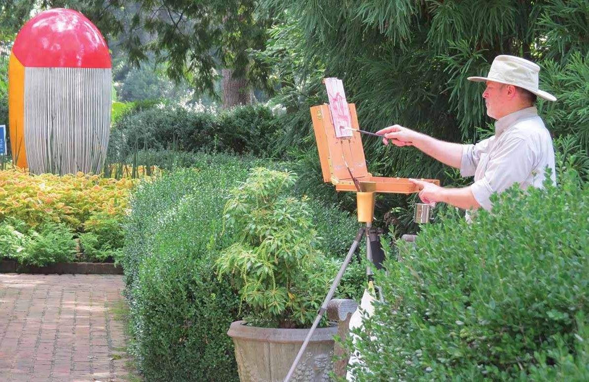 An artist paints on the grounds of the Dixon Gallery & Gardens in Memphis, Tenn.