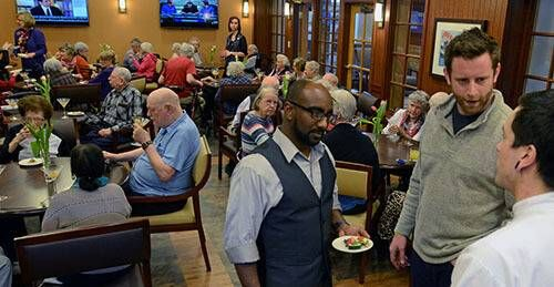 Al Baker and Ahmed Daoud interacting with Brookdale residents at a happy hour.