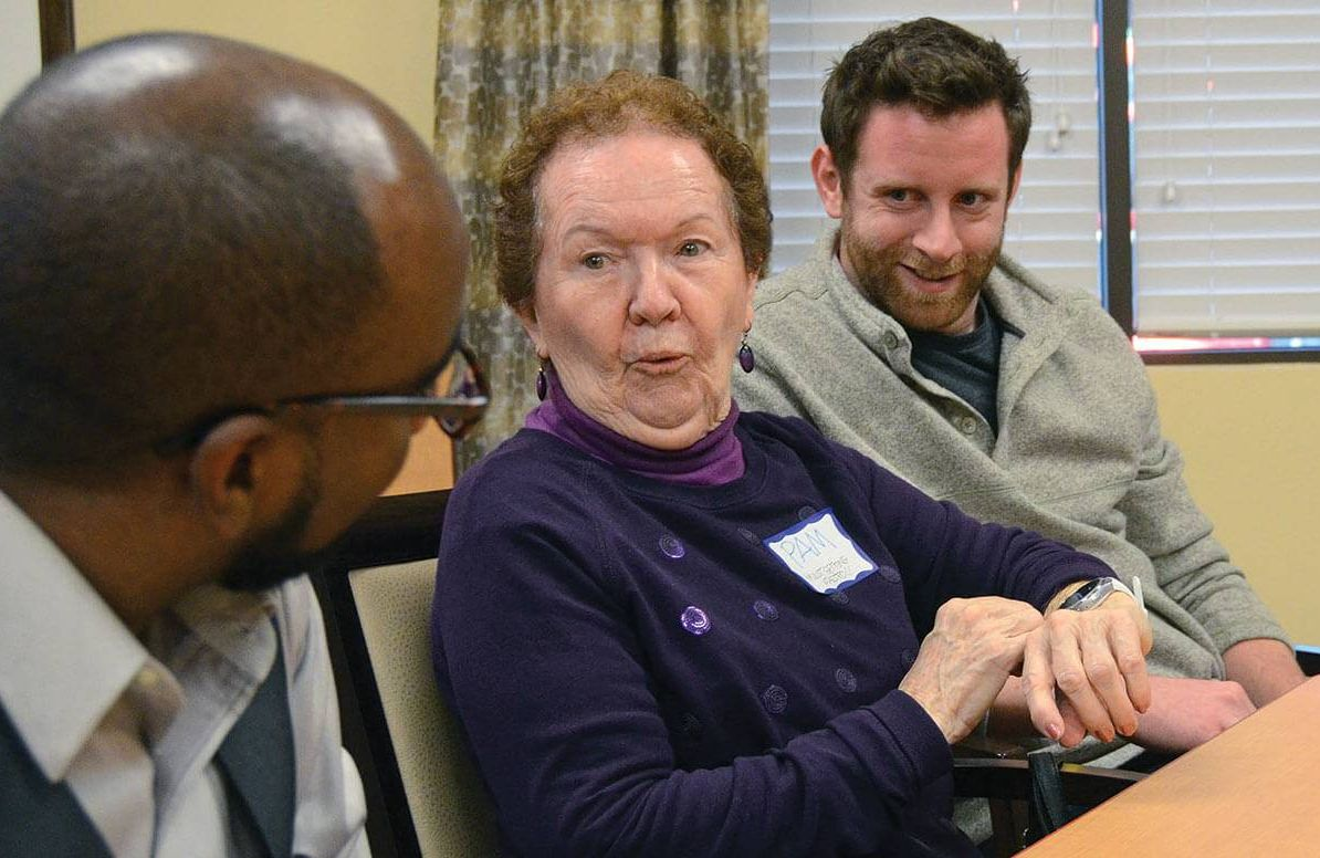 Reemo CEO Al Baker, 25, and CTO Ahmed Daoud, 32, showing their smart watch to 78-year-old Pam Paul, a resident at Brookdale Senior Living in Edina.