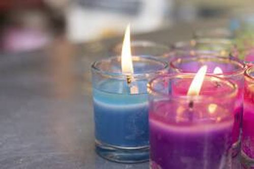 colorful burning candle in glasses
