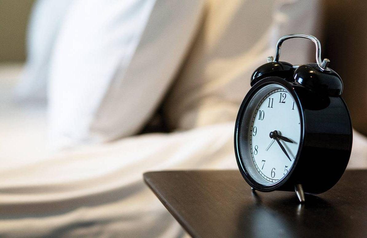 Alarm clock and empty bed
