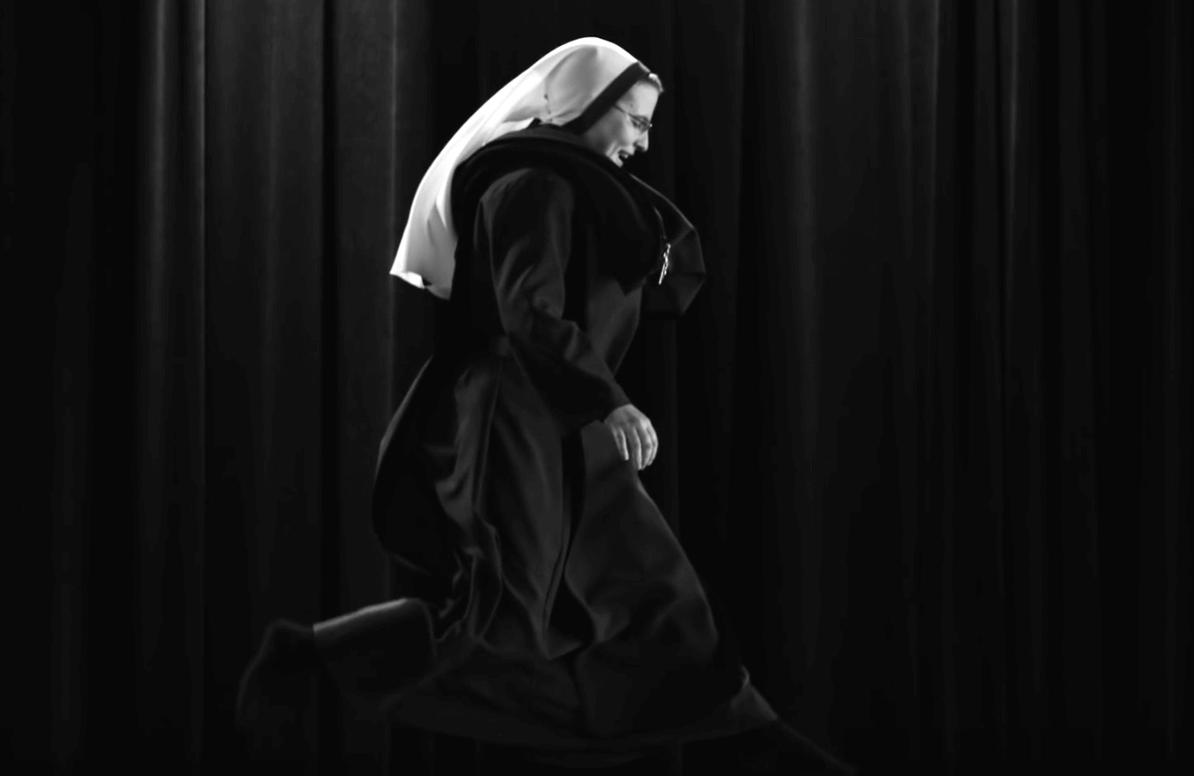 Nun jumping on a trampoline
