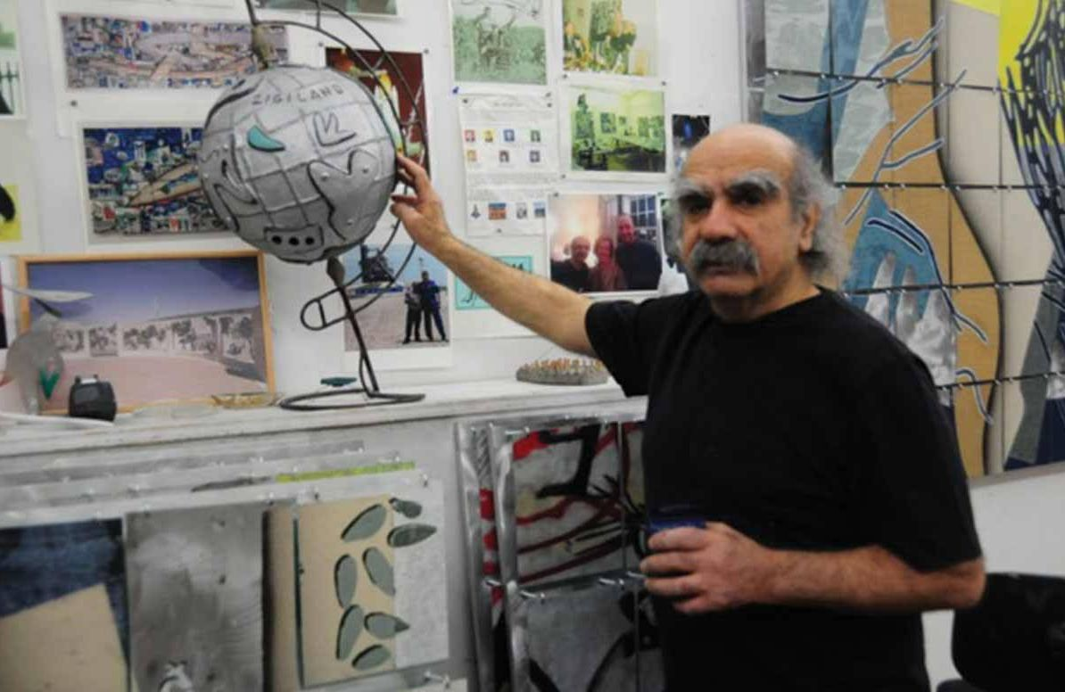 "Zigi Ben-Haim with the ""Zigiland"" Globe."