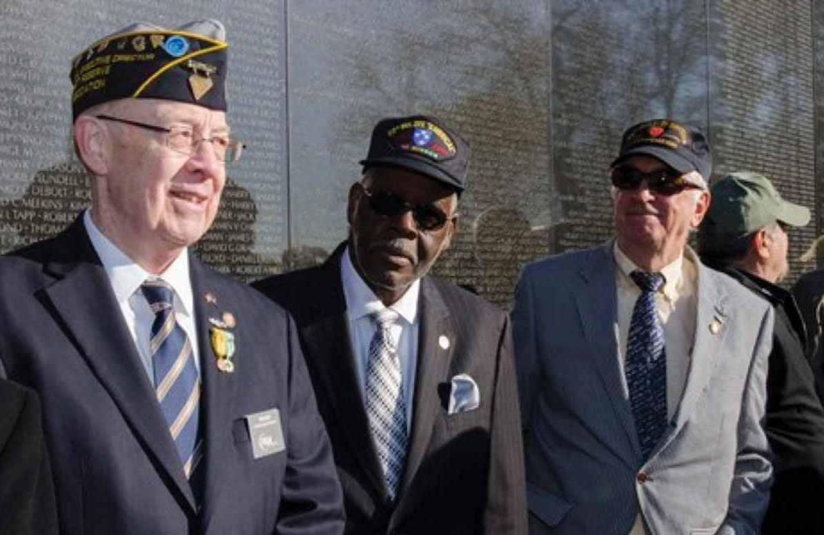 Vietnam veterans share a moment after a wreath-laying ceremony at the Vietnam Veterans Memorial in Washington DC.