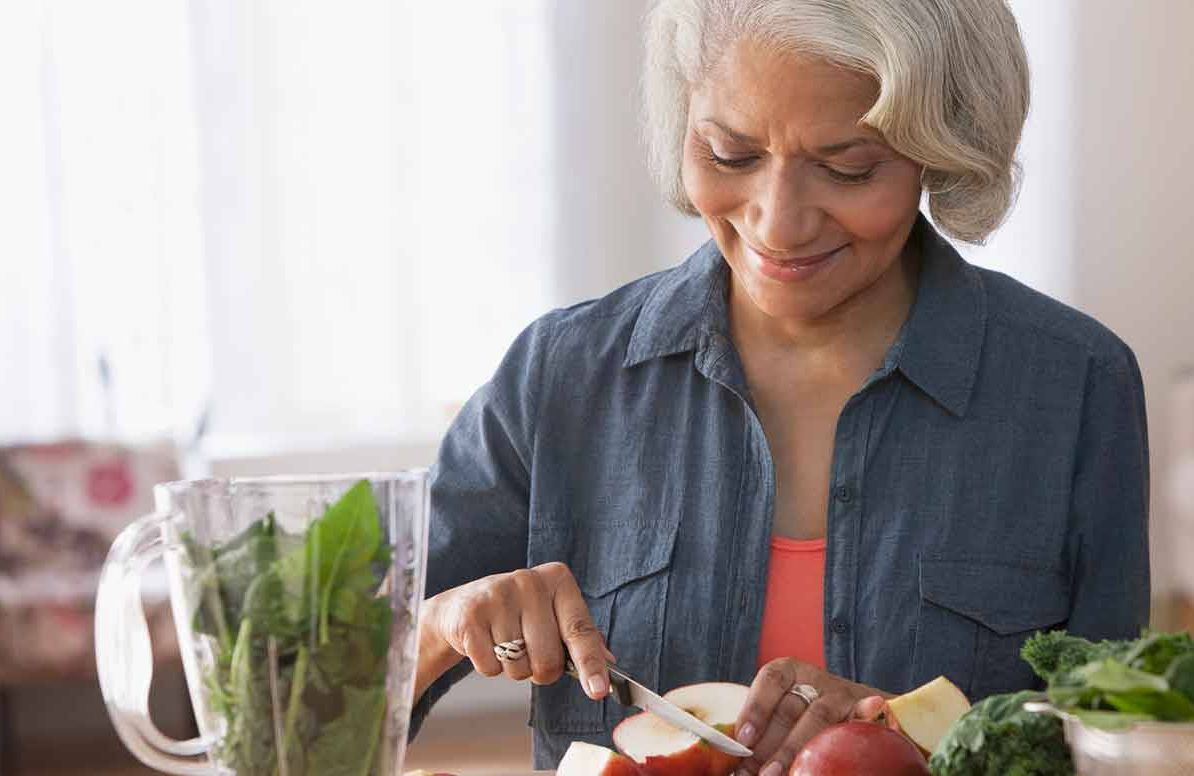 Woman prepping healthy foods