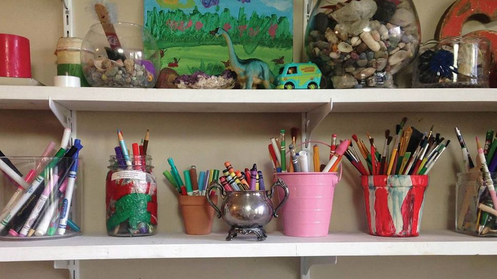 """After taking a painting class, I decided to turn my dining room into a """"mini makerspace"""" to spur creativity — the shelves are now stocked with items like paintbrushes and glue sticks."""