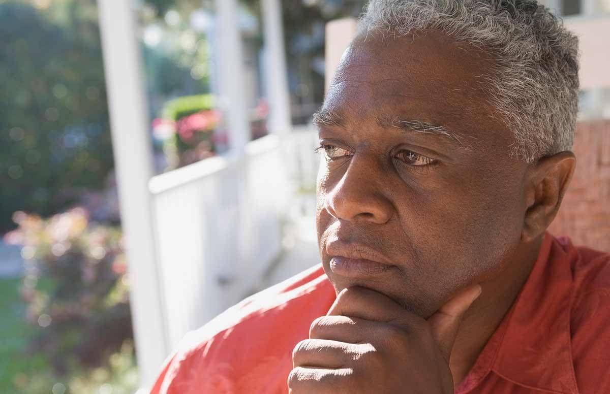 Sad older man thinking