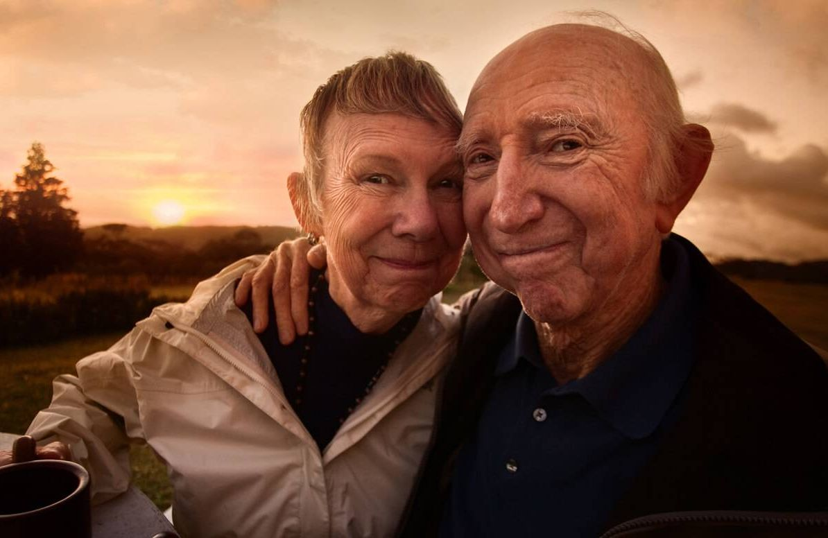 older couple by lake