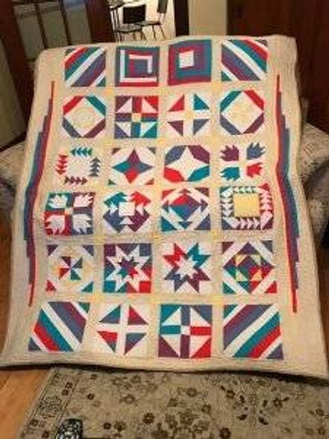 Quilt with multicolored square designs.
