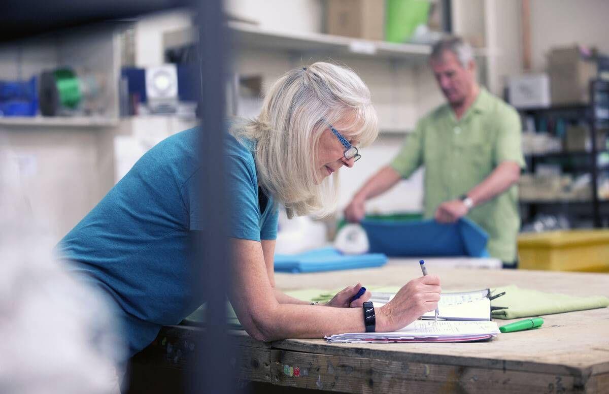 Businesswoman Doing Stock Paperwork