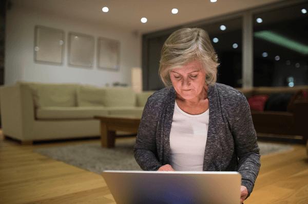 woman in a livingroom on alaptop