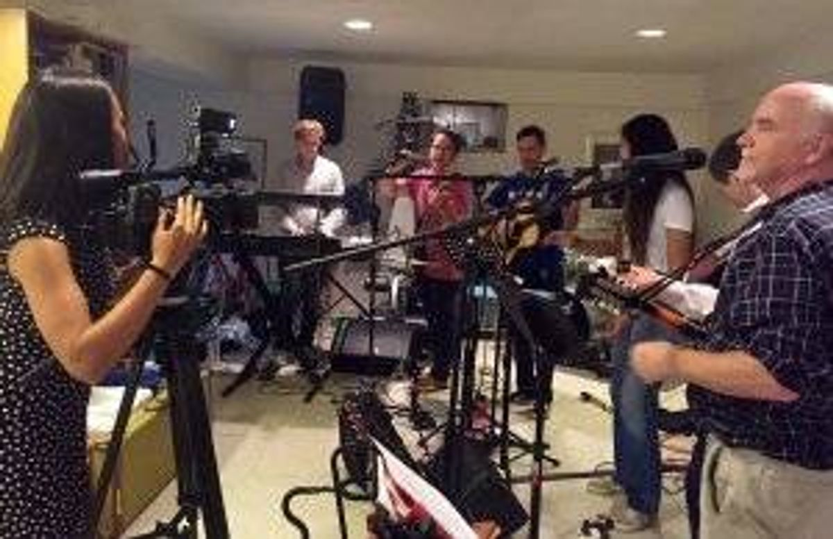 Crys Young, Dr. John O'Shea, and other NIH scientists gather at Dr. Shea's house to jam.