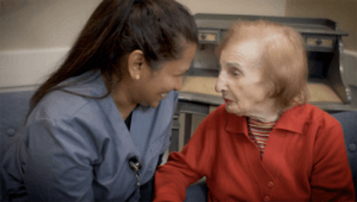 Staff member with a resident of United Hebrew's Memory Care Community, Willow Gardens Memory Care