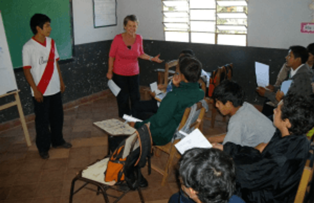 Middle-school student in Paraguay getting tips on public speaking