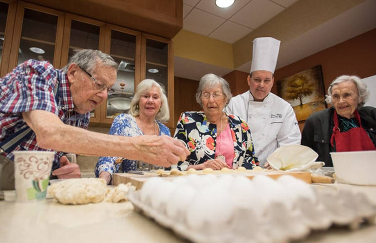 Residents of United Hebrew's assisted living and memory care community in New Rochelle, N.Y., learn how to make pasta from the facility's head chef