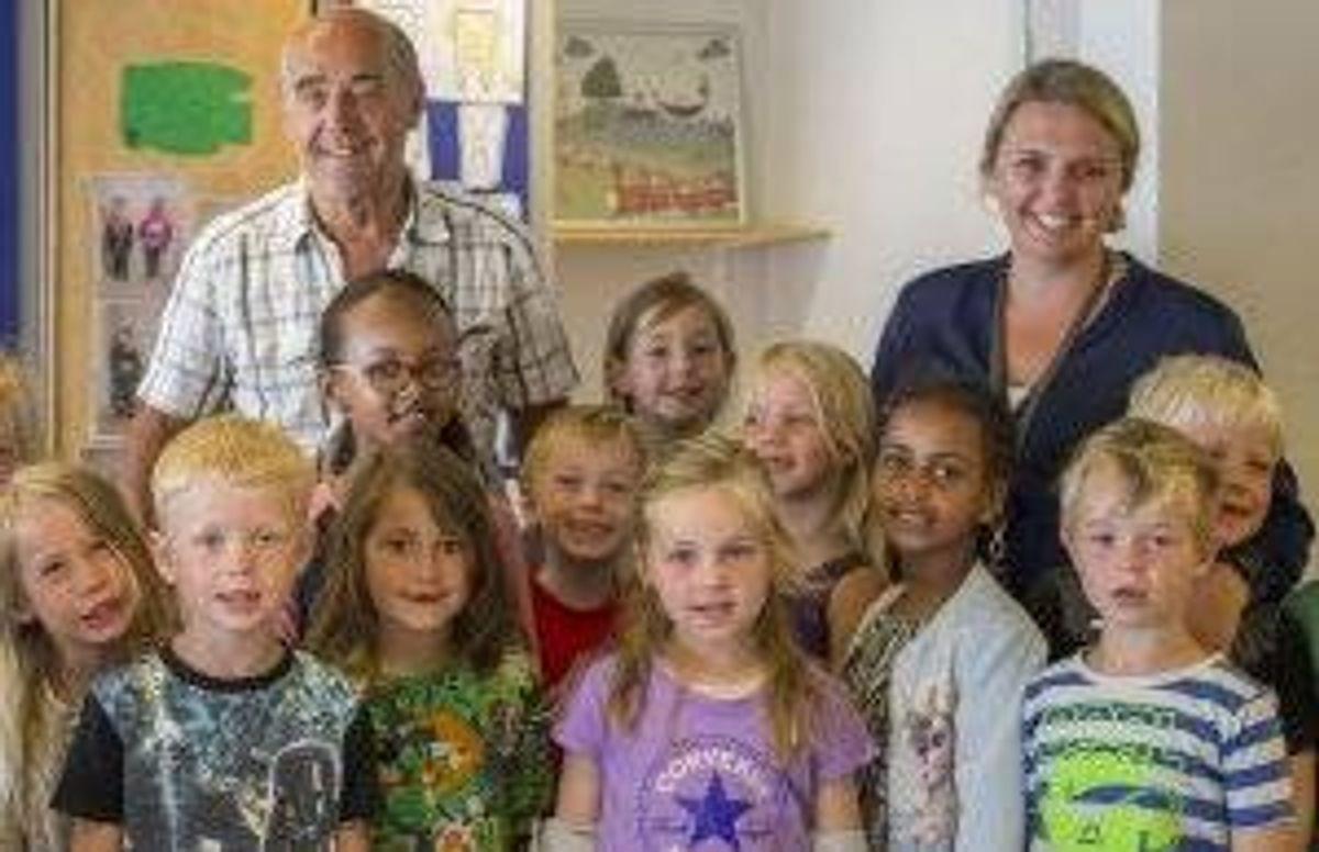 Poul-Erik Tindbaek, a School Uncle, with a class of students