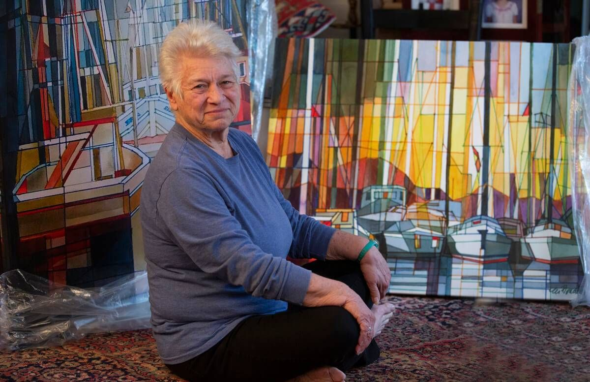 Artist Marilynne Bradley at home in Webster Groves, surrounded by her artwork, including some of her latest work, geometric watercolors on canvas which are being readied for a show at the St. Louis Artist Guild.