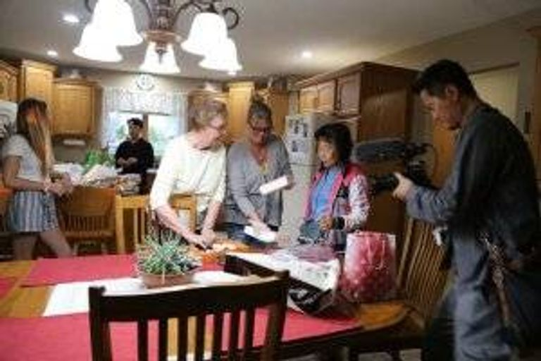 Fostervold's adoptive mother and sister Lynn Wells, 51, exchange gifts with his biological mother, as Korean filmmaker Wangmo Yeon captures the moment.