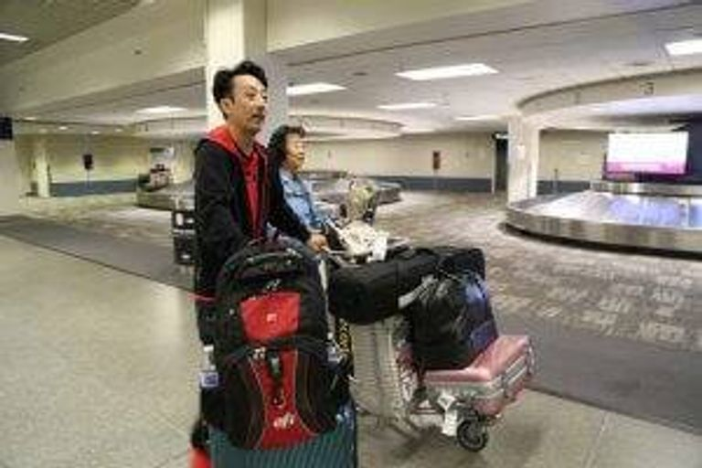 Layne Fostervold, 47, and his Korean mother, Sook-nyeon Kim, 71, arrive at Minneapolis-St. Paul International Airport on Sunday.