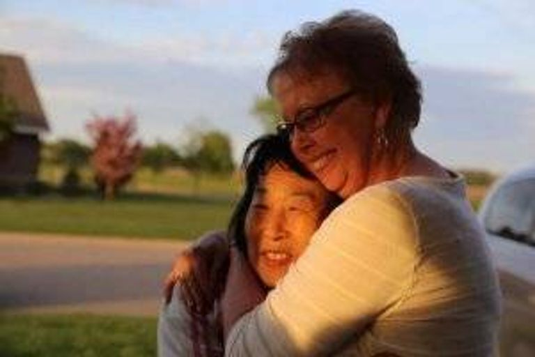 Sook-nyeon Kim, 71, and Lois Fostervold, 75, embrace after meeting for the first time in Willmar, Minnesota.