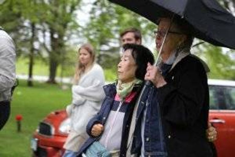 The two mothers watch the Memorial Day tribute at a cemetery in Willmar, Minn.