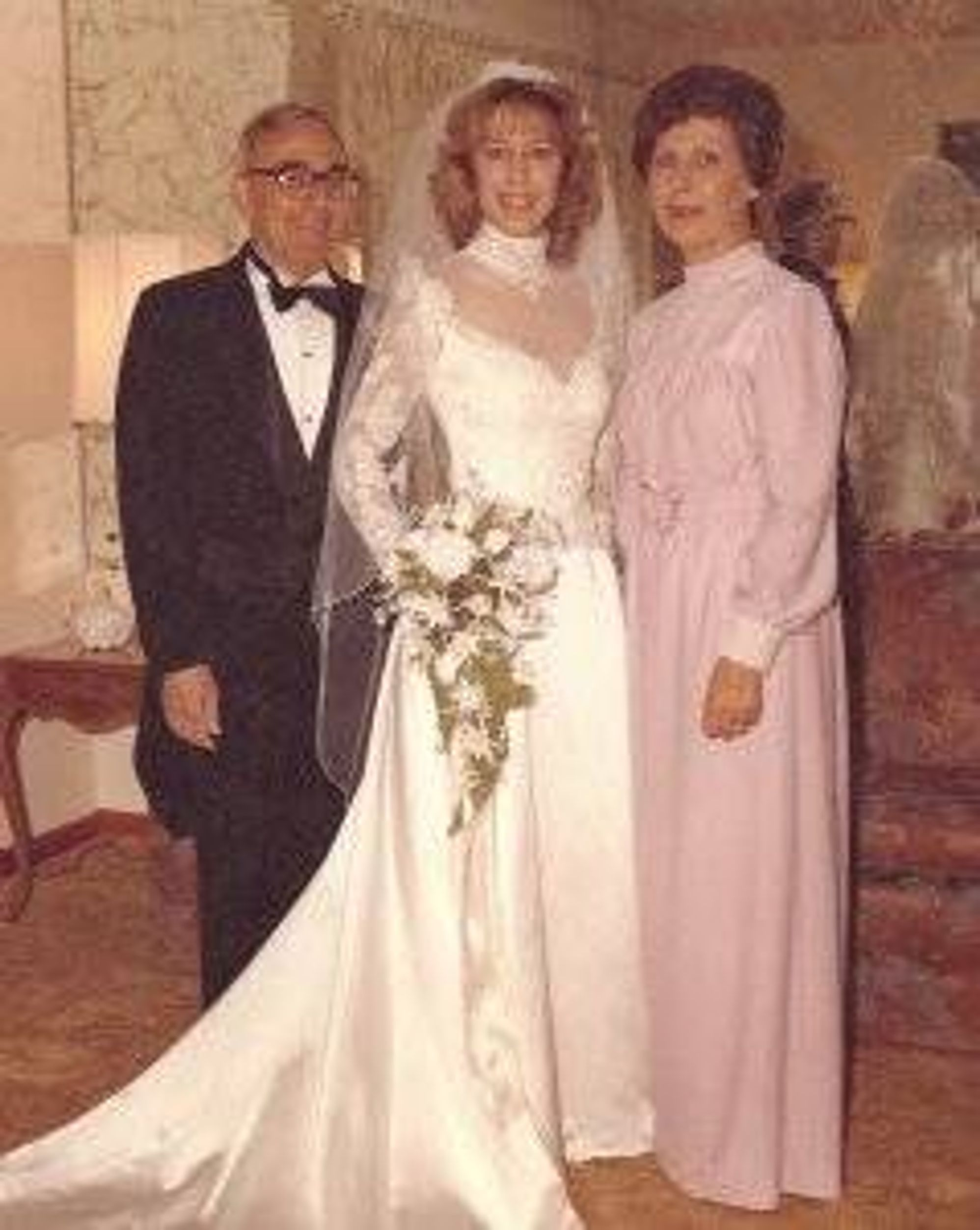 Patricia and her parents on her wedding day