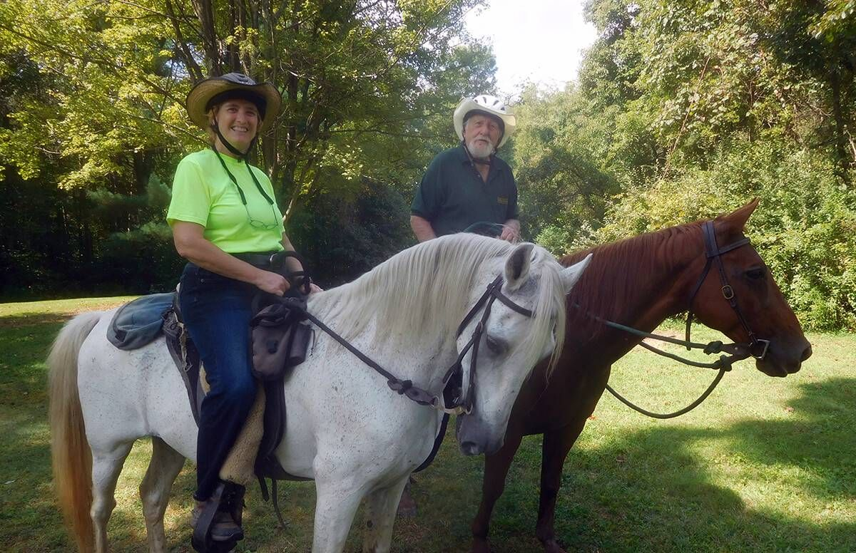 Jeanette and Roy Henderson take a break during a ride with their horses.