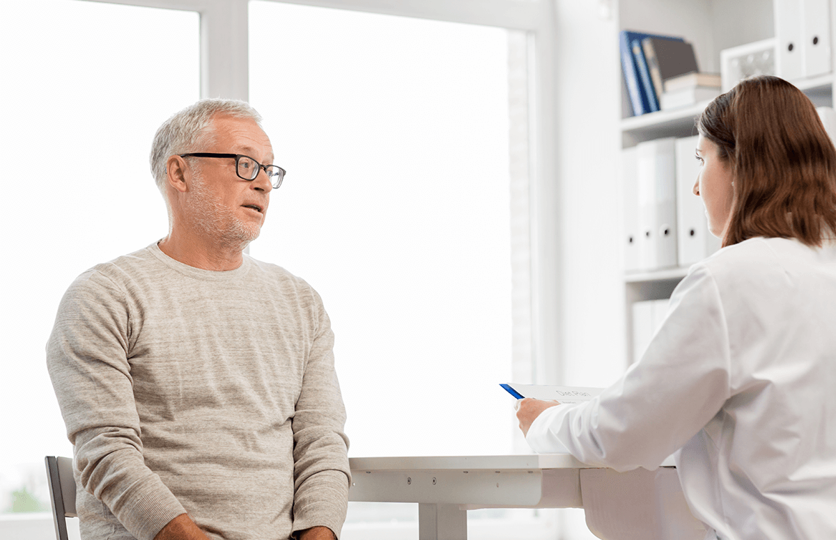 middle aged man consulting with his doctor