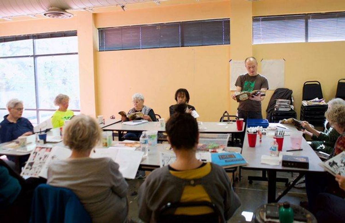 Teaching artist Masanari Kawahara (standing) leads a discussion on visual imagery