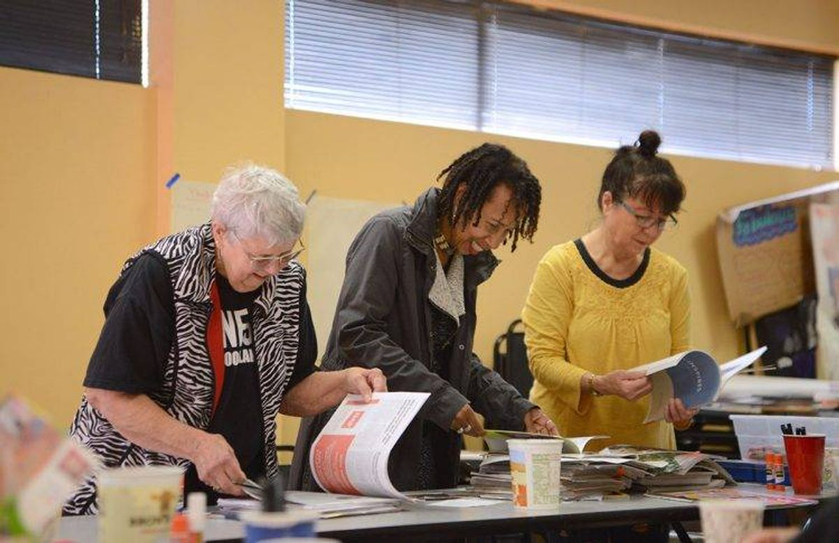 Students peruse magazines for visual inspiration. (From left to right) Judy Baldwin, Beverly J. Davis and Kyoko Katayama