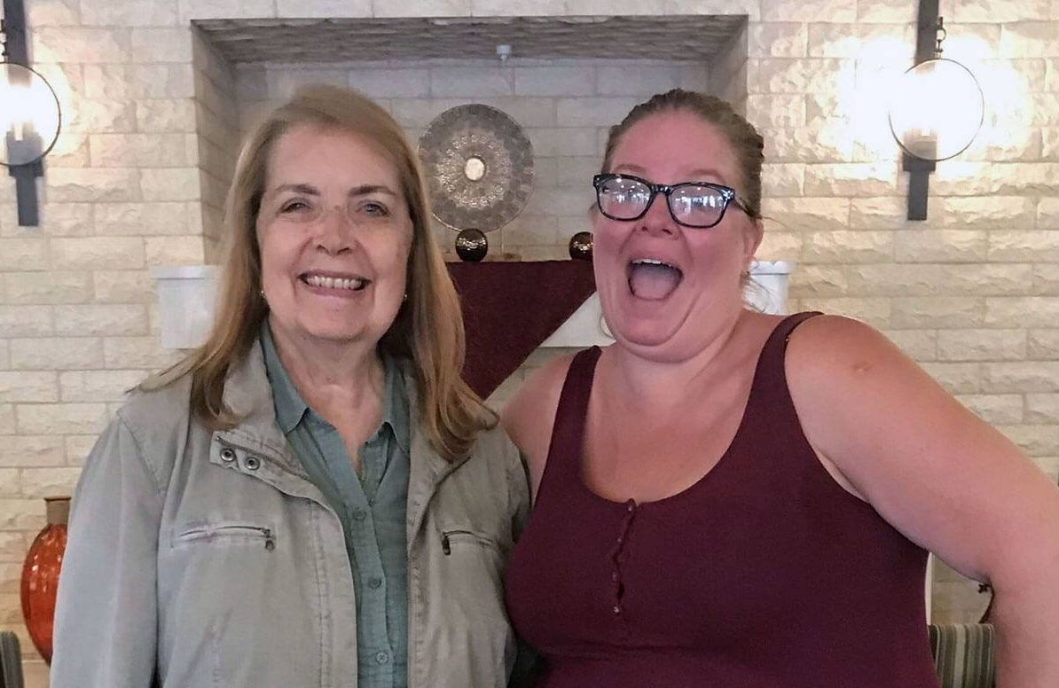 Carmen Saperstein, left, 70, who has Alzheimer's disease, poses with professional comedian Angela Dirksen of Laughter On Call in Los Angeles.