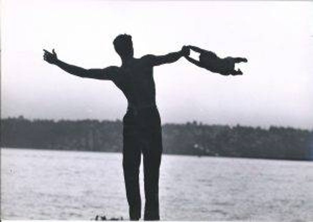 Jacques d'Amboise plays with his son Christopher on Mercer Island, Washington, in 1962