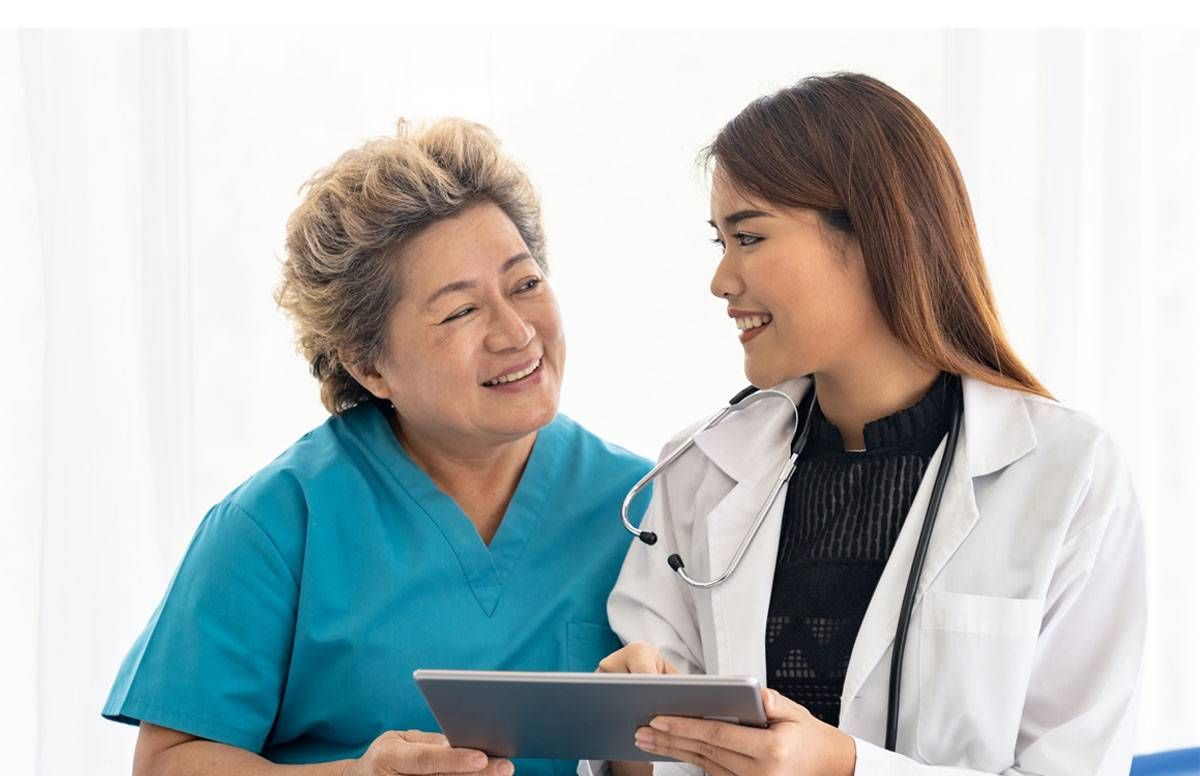Doctor cheerfully consulting with patient