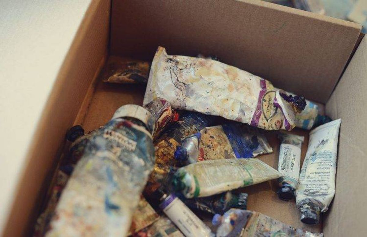 a box of partially used paint tubes that belong to Minneapolis artist James Wrayge