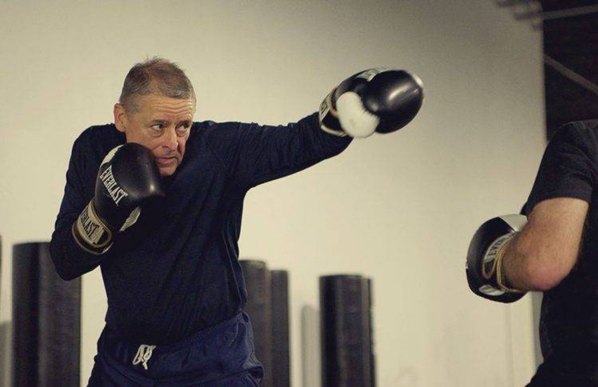 Steve Johnson (left) shows intense focus while practicing punches with fellow boxing student Tom Ryan.