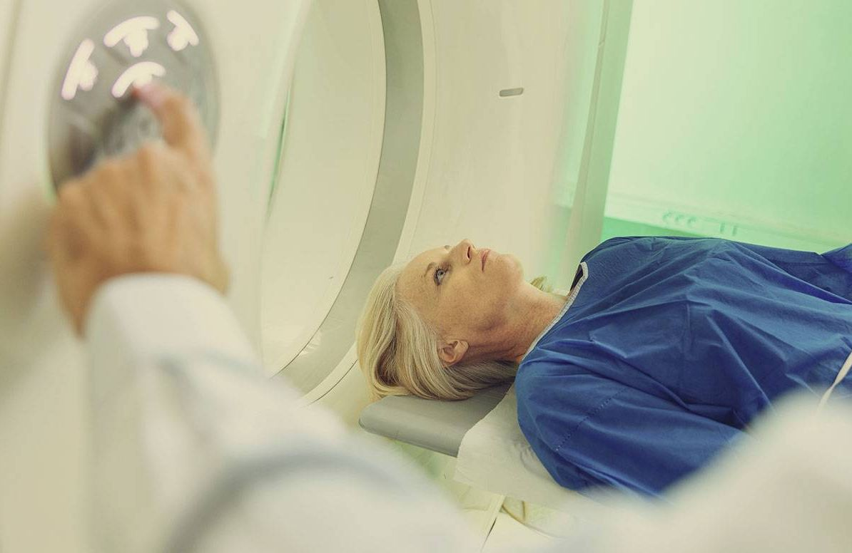 a woman entering an MRI machine