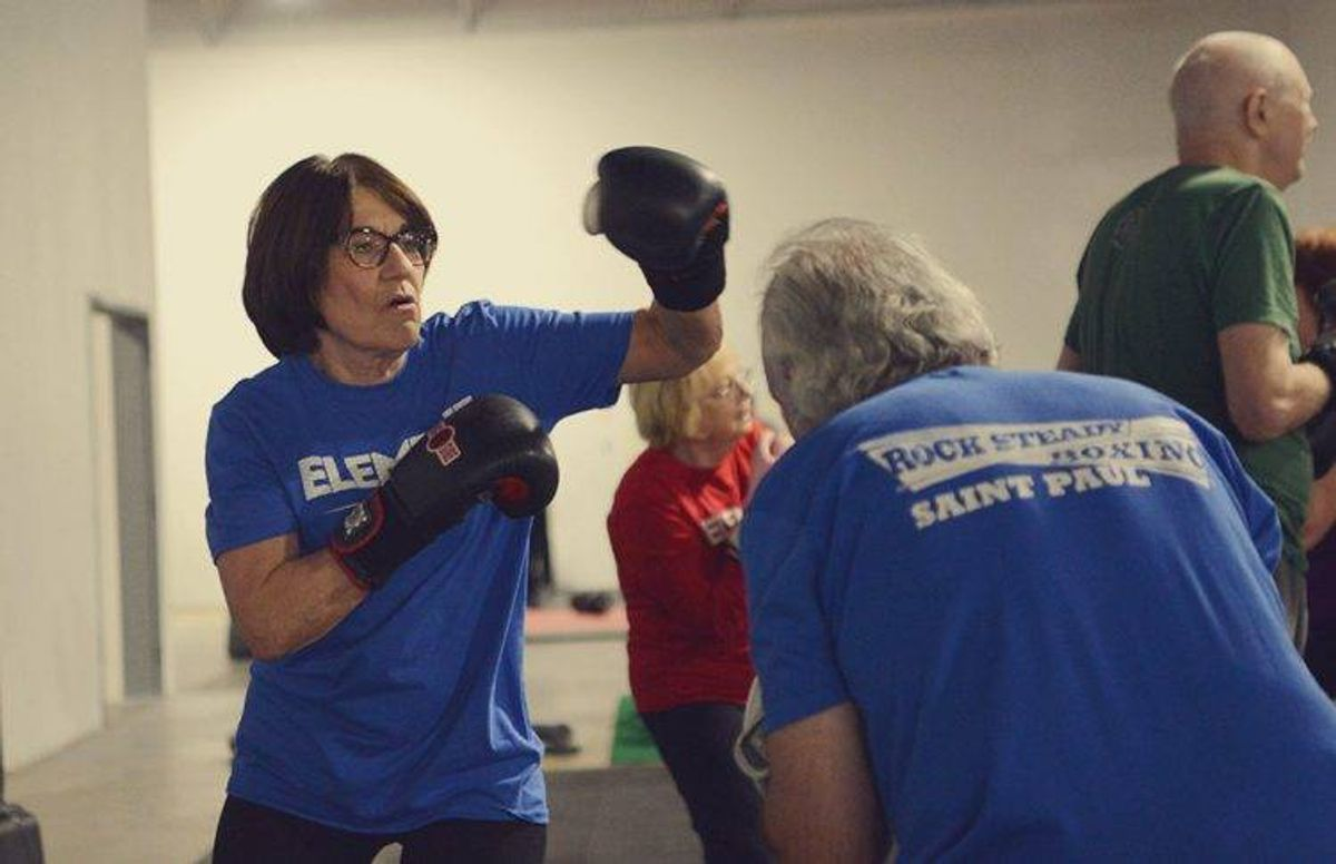 Sheila Proehl partnered up with fellow boxing student Jim Hunt for the punching sequences exercise.