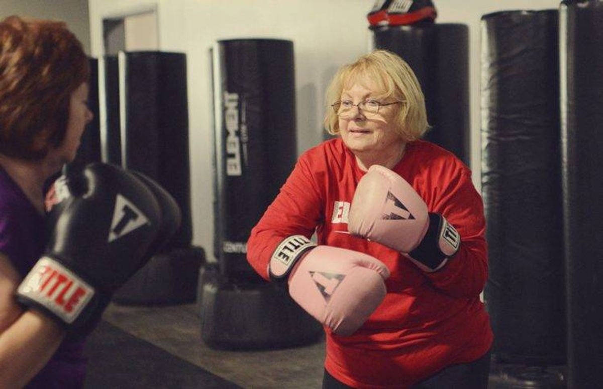 Bette Forster (right) practices a hook punch with fellow student Vicky Stanich.