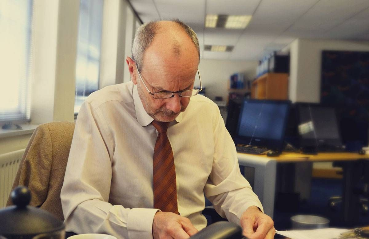 middle aged man working in an office