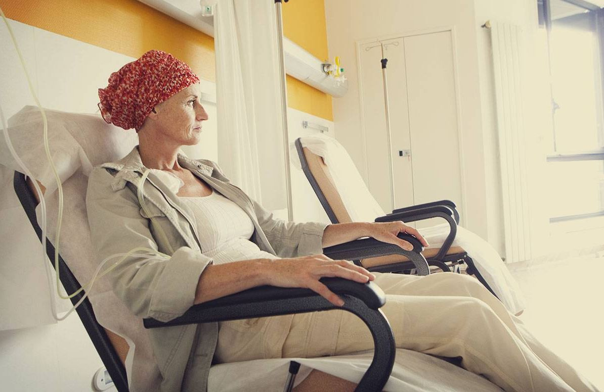 middle aged woman undergoing chemotherapy treatments