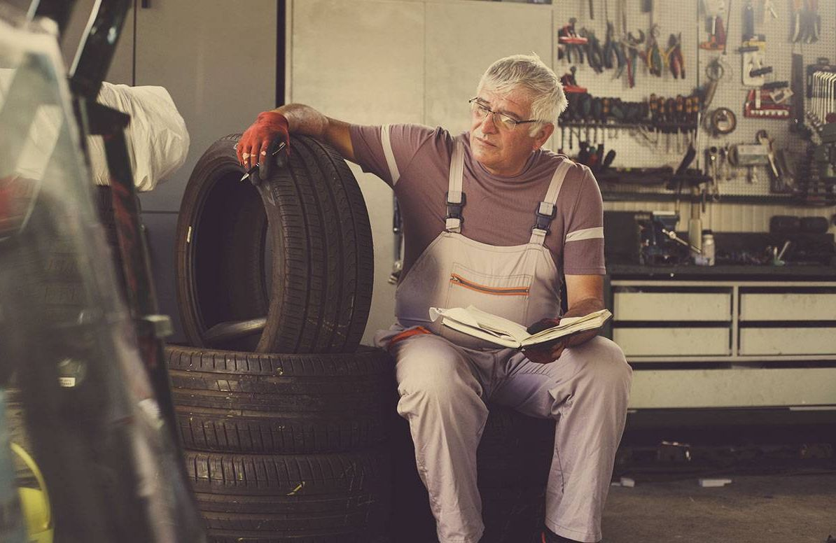 A middle-aged man running his small business repairing vehicles