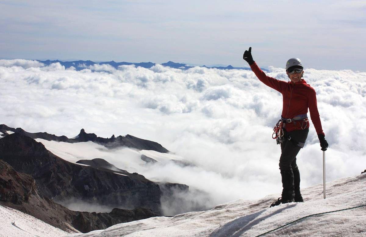 Joy Rikala celebrates her climb above the clouds on Mount Rainier in Washington