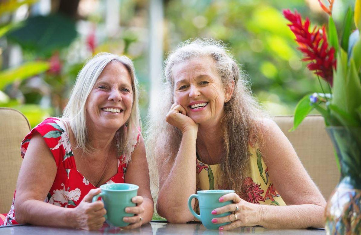 Older couple enjoying coffee in the sunshine,