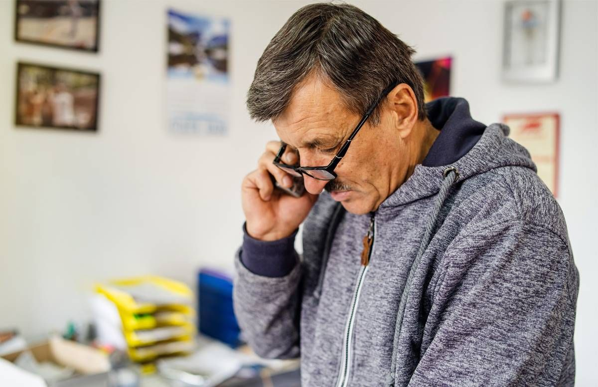 Man on phone rescheduling an appointment