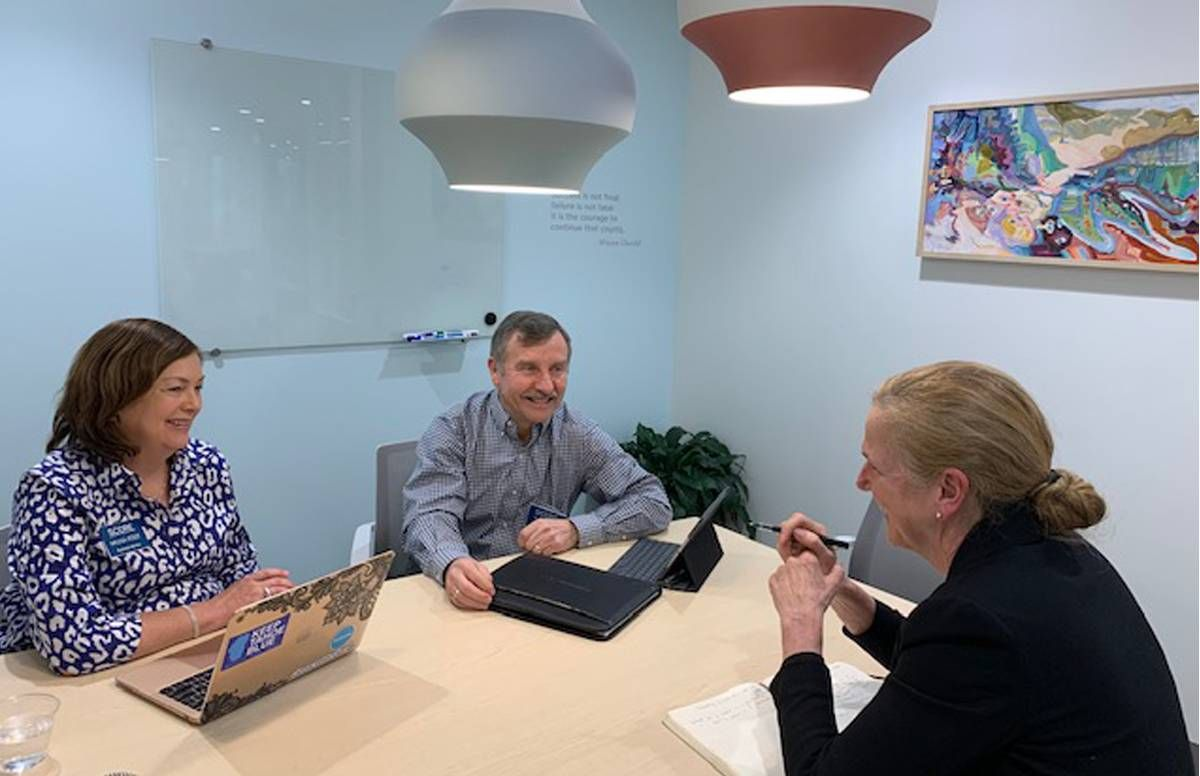 SCORE mentors Meleisa Holek and Bob Hogan meet with a client