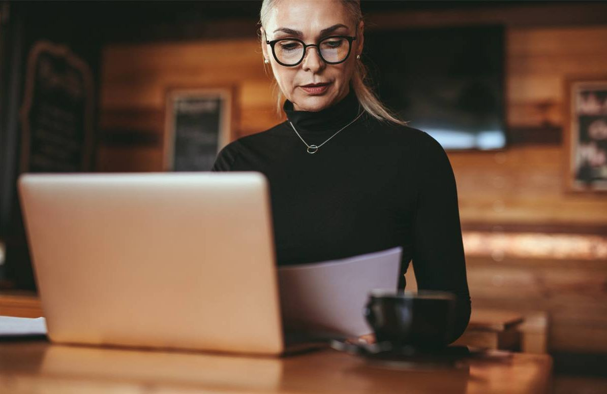Woman reviewing finances or other type of retirement planning