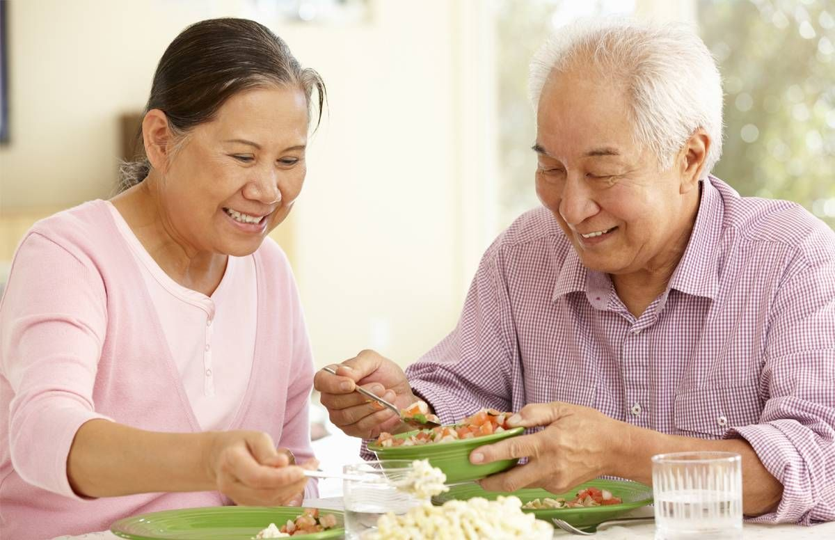 older couple eating at home